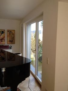 The grand piano in the former living room