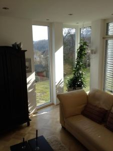 The new living room: the windows to the right protected by external Venetian blinds