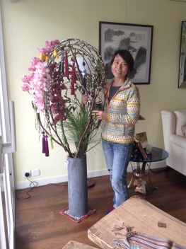 Florist Friend Lowdi Kwan of Tallensia Florist next to her Spring Orchid Creation