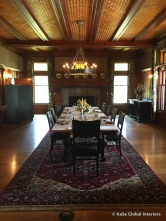 Dining room: woven redwood pnels, oriental carpet, dark wood furniture (replicas)