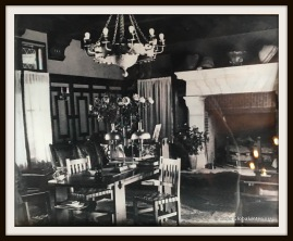 Living room: historical picture showing the enormous fireplace and the Spanish chandelier