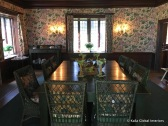 Dining room: the use of patterns is mainly reserved for window and wall treatments. Furnishings (apart from the seat cushions), flooring and ceiling are left plain
