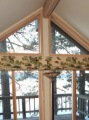 Pine cone patterns on heavy roman blinds, blocking out the light and distracting from the beautiful exterior views.